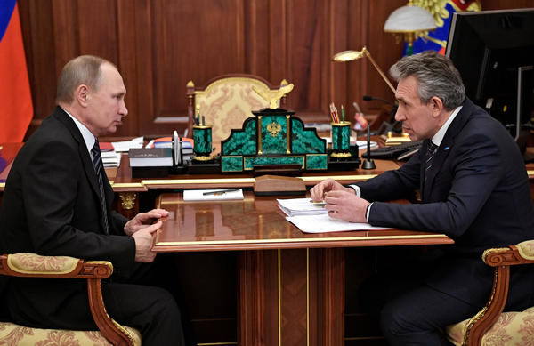 Russian President Vladimir Putin (left) meets with Vnesheconombank bank chairman Sergei Gorkov in the Kremlin in Moscow, Russia, in February.