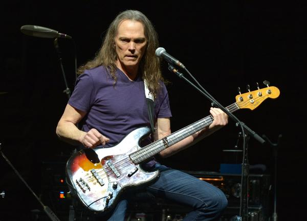 """Timothy B. Schmit of The Eagles performs on the """"History of the Eagles"""" tour in 2014 in Los Angeles. (John Shearer/Invision/AP)"""