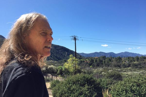 Schmit outside his home in California's Santa Monica Mountains. (Robin Young/Here & Now)