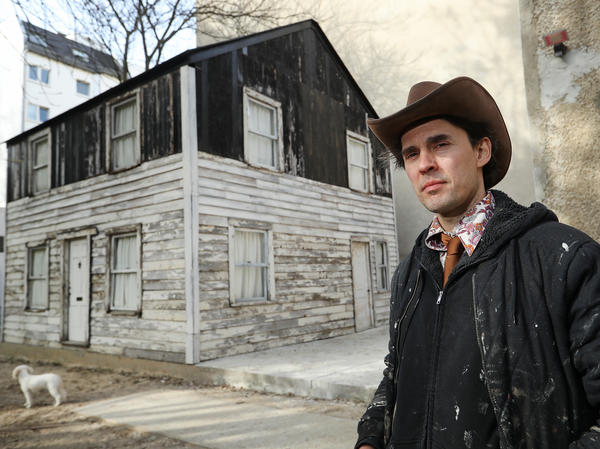 U.S. artist Ryan Mendoza poses for a photo next to the former house of Afro-American human rights figure Rosa Parks on Mendoza's property on April 6, 2017 in Berlin, Germany. Mendoza bought the house, which was slated for demolition in Detroit, took it apart, shipped it to Germany, and put it back together again on the property next to his studio.