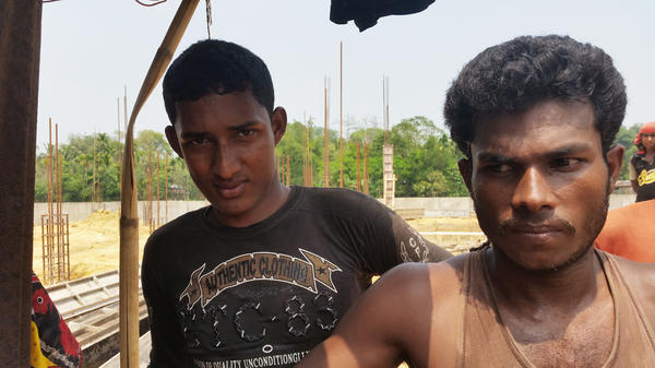 Habibur Rahaman (left) and Alauddin are Bangladeshi construction workers who worry that the influx of Rohingya refugees will make it harder to find a job. They say Rohingya are willing to work for half the wages that Bangladeshis get.