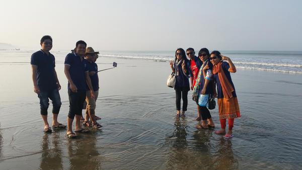 Tourists gather on the beach in Cox's Bazar, Bangladesh's current beach destination.