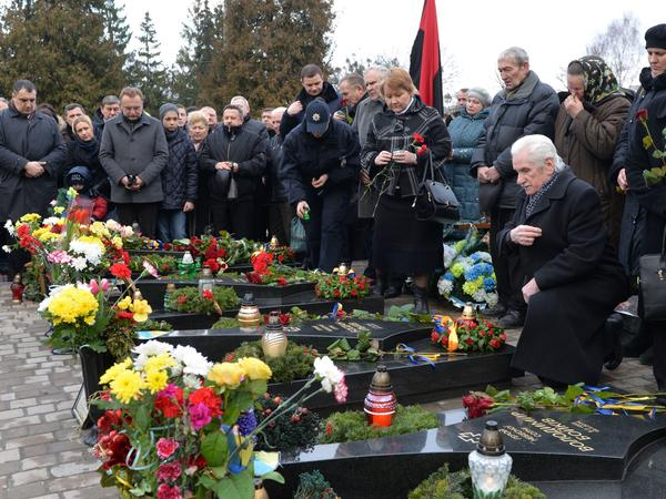 On the second anniversary of the 2014 shooting of anti-government protesters, people attend a memorial ceremony at the graves of slain Maidan activists in the western Ukrainian city of Lviv.