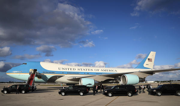 President Trump arrives at Palm Beach International Airport in Florida on Air Force One to spend Easter weekend at Mar-a-Lago resort on Thursday.
