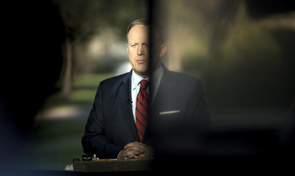 White House press secretary Sean Spicer waits for an interview on Tuesday to speak about a comparison he made between Syria's President Bashar Assad and Hitler during an earlier press briefing at the White House.