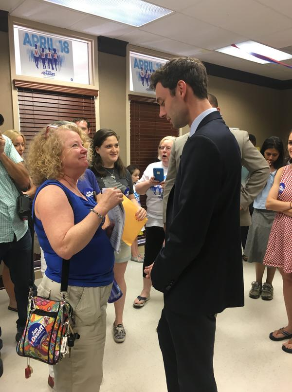 Democratic congressional candidate Jon Ossoff greets a volunteer at his Sandy Springs campaign office on Saturday afternoon.