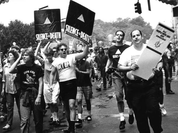 Members of ACT UP hold up signs and placards during the Gay and Lesbian Pride march in New York City, June 26, 1988.