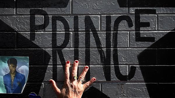 The star of music legend Prince, painted on the outside wall of First Avenue, featured in the film <em>Purple Rain</em>, in Minneapolis, Minnesota, two days after his death on April 21, 2016.