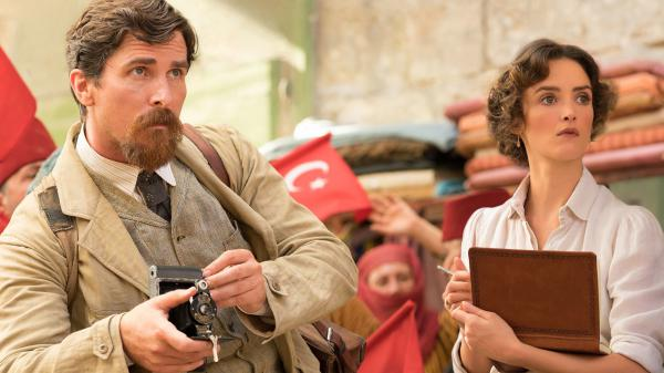 Chris (Christian Bale) and Ana (Charlotte Le Bon) have a reason to look worried in Terry George's <em>The Promise</em>.