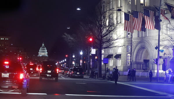 President Trump's motorcade heads down Pennsylvania Avenue as he goes to dinner at the Trump International Hotel on March 25.