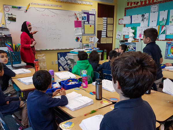 Souad Mohammad teaches Arabic to a third-grade class at Al Fatih Academy in Reston, Va.