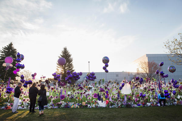 Fans visit a memorial created outside Paisley Park on April 23, 2016.