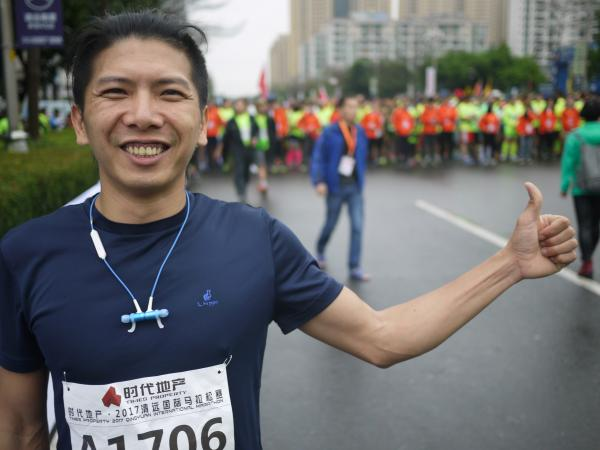 Runner Xu Ting, just before starting his first full marathon, in Qingyuan, China, says he's prepared a long time for this race — even suspending his two-pack-a-day smoking habit for five days in the hope of running faster.