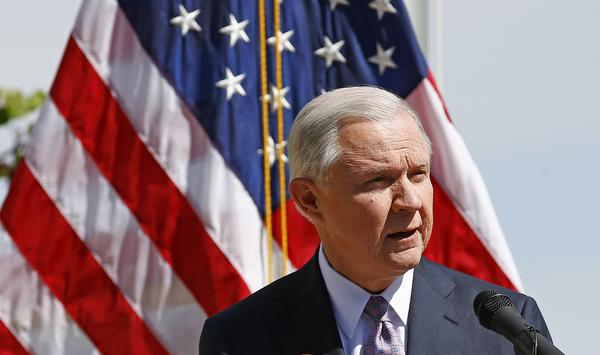 Attorney General Jeff Sessions speaks at a news conference after touring the U.S.-Mexico border on April 11. The Justice Department is warning so-called sanctuary cities that they must prove they are complying with federal immigration laws or risk funding.