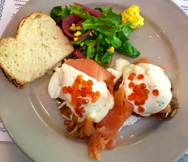 The Benny Goodman at Perly's Restaurant and Deli in Richmond, Va.: two latkes (potato pancakes) topped with smoked salmon, poached eggs, dull hollandaise and salmon roe. (Kathy Gunst for Here & Now)