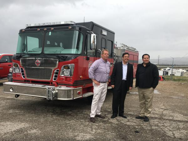 Rep. Raul Labrador, R-Idaho, center, poses with Chad Moffat, left, and Var Reeve, right, who run Boise Mobile Equipment, an Idaho company that makes fire rescue vehicles.