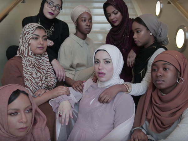 """Mona Haydar (center), a Syrian- American artist from Flint, Mich., released her first rap song, """"Hijab,"""" along with an accompanying video."""