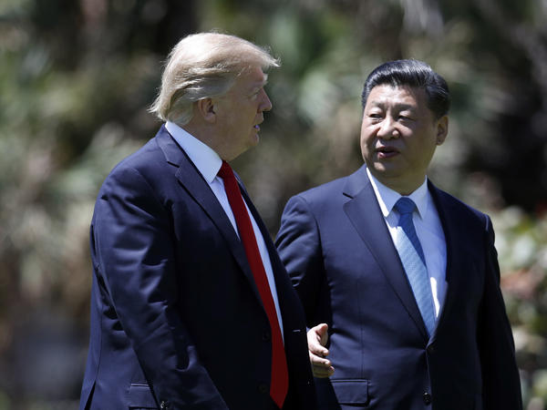 President Donald Trump and Chinese President Xi Jinping walk together after their meetings at Mar-a-Lago, on Friday, April 7, 2017, in Palm Beach, Fla.