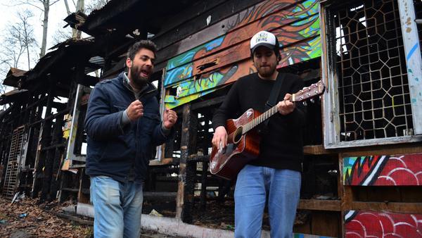 Guitarist Ali Saifudin (right) collaborates with local rapper Mu'Azzam Bhat.