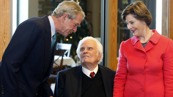 Former President George W. Bush and Laura Bush greet evangelist Billy Graham in 2010.
