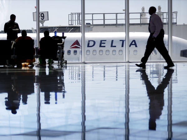 Delta recently authorized supervisors to offer up to $9,950 in compensation to passengers bumped from flights. A Delta Air Lines jet sits at a gate at Hartsfield-Jackson Atlanta International Airport.