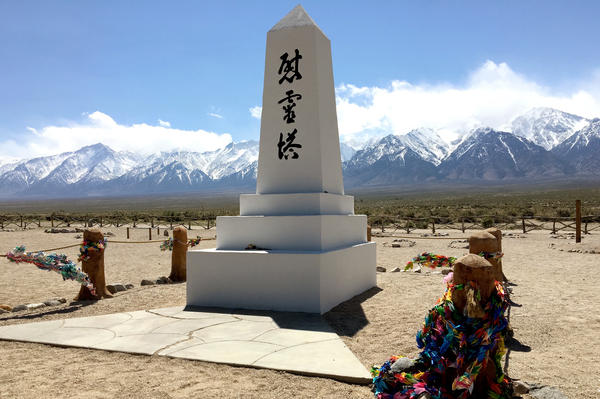 The Manzanar cemetery includes a white obelisk monument in the midst of a wide clearing, making it feel lonely.