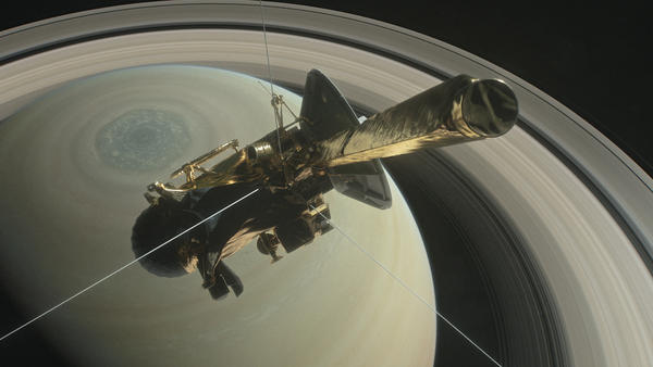 NASA's Cassini spacecraft made its first dive between Saturn and its rings early Wednesday, as the final act in a nearly 20-year mission.