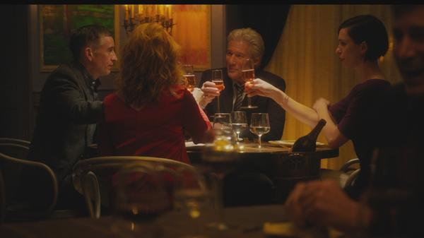 """Go on, do your Michael Caine!"": Paul (Steve Coogan), Claire (Laura Linney), Stan (Richard Gere) and Katelyn (Rebecca Hall) get toasted in <em>The Dinner</em>."