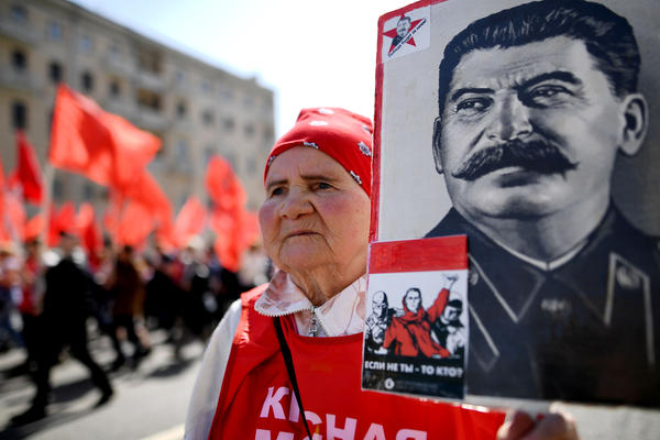 A Russian Communist Party activist carries a banner with a portrait of late Soviet leader Joseph Stalin during a May Day rally in central Moscow on Monday.