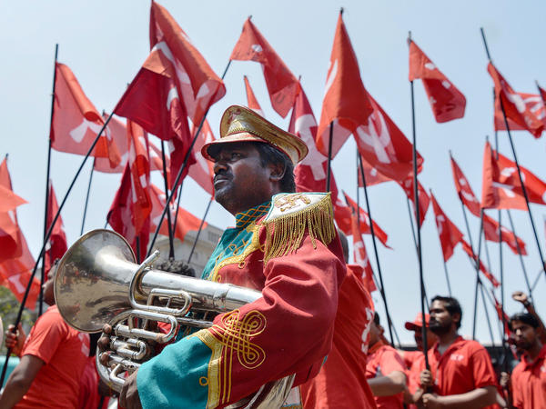 Indian workers and members of various trade unions dressed in red take part in a rally on the occasion of International Workers' Day in Bangalore on Monday.