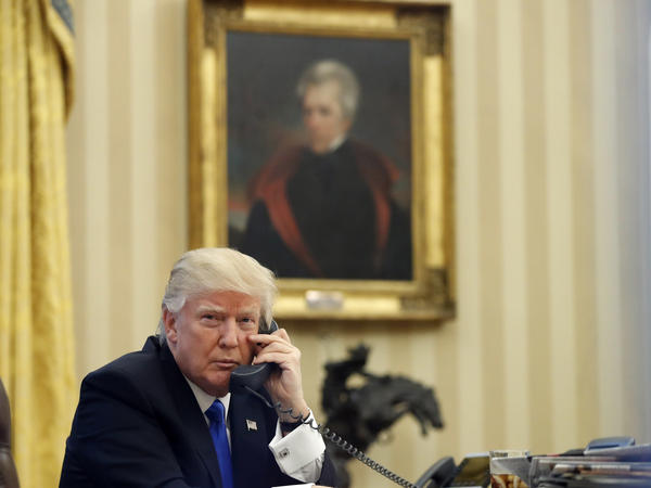 President Donald Trump speaks on the Oval Office telephone in January, as a portrait of former President Andrew Jackson hangs in the background. In an interview published Monday, Trump wondered aloud about whether the Civil War would have happened had Jackson been alive in the 1860s.