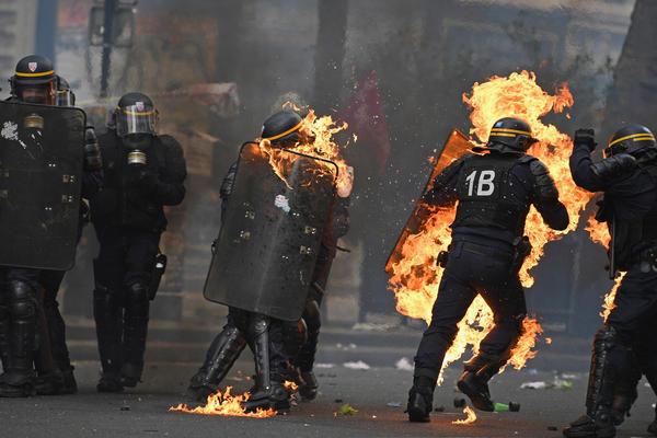 In Paris, May Day protesters threw gasoline bombs, causing fire on the streets and leaving at least one police officer badly burned on Monday.