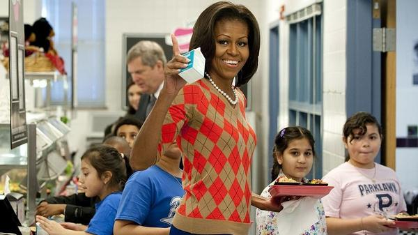 Former first lady Michelle Obama waves alongside school children while walking down the school lunchline after getting turkey tacos at Parklawn Elementary School in Alexandria, Va., in January 2012 to promote new nutritional guidelines for school lunches.