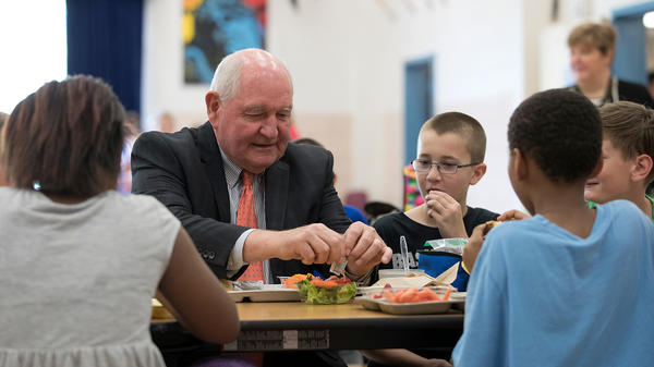 Agriculture Secretary Sonny Perdue eats lunch with students at the Catoctin Elementary School in Leesburg, Va., on Monday.