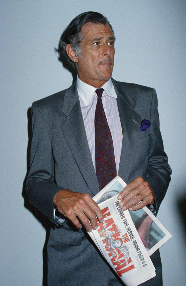 Frank Deford on June 12, 1991, holding a prototype of the final edition of <em>The National,</em> a sports daily where he served as editor in chief from 1989-1991.