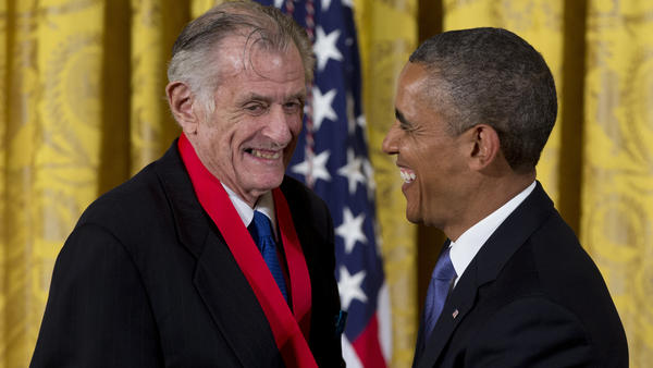 President Barack Obama laughs with Frank Deford as he awards him the 2012 National Humanities Medal for transforming how we think about sports, during a ceremony in the East Room of White House on July 10, 2013.