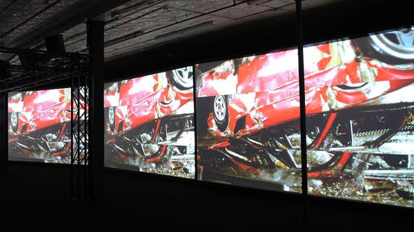 The video installation <em>Inevitable</em>, by Birch and Eric Hu, shows a Hong Kong stunt man flipping Birch's red Ferrari.