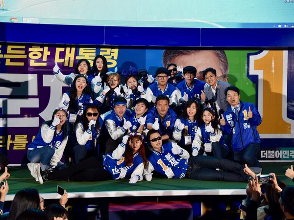Moon supporters wear matching outfits for their K-pop performance in Seoul. The signature colors and dance moves are part of an unusual kind of campaigning in South Korea.