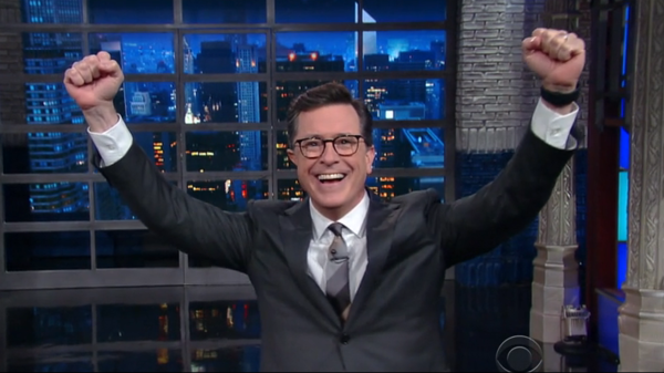 On Wednesday's <em>Late Show,</em> host Stephen Colbert celebrated not being fired from his job. A #FireColbert campaign began after the comedian unleashed a barrage of insults aimed at President Trump on Monday's show.