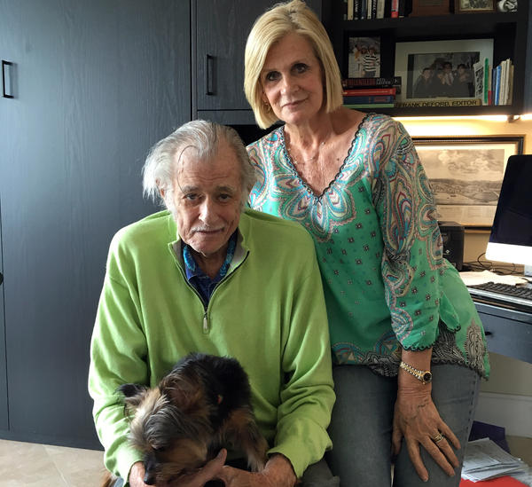 Frank Deford, his wife, Carol, and their dog, Miss Snickers, in his home office in Key West, Florida. On Wednesday, Deford retired from <em>Morning Edition</em> as sports commentator.