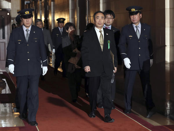 Yasunori Kagoike (center) head of an ultra-nationalistic Japanese school operator, walks through the hallway after testifying before an upper house panel at the parliament in Tokyo on March 23.