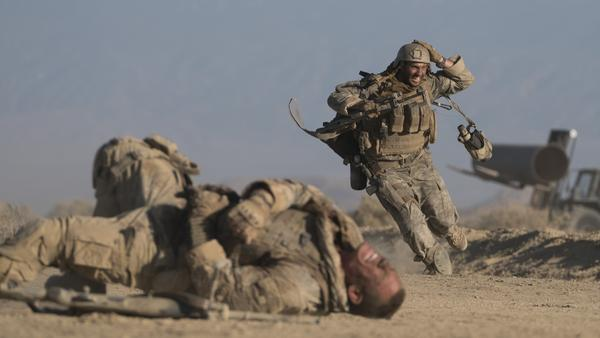 Easy Targets: Matthews (John Cena) and Isaac (Aaron Taylor-Johnson) seek cover in <em>The Wall</em>.