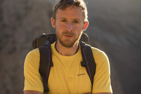 Tommy Caldwell poses for a portrait after just climbing to the top of Tadrarate via a 500m, 7c climbing route. He's climbing with Alex Honnold in Taghia, Morocco. September 20th, 2016.