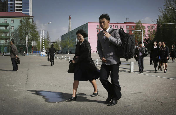 North Koreans walk in downtown Pyongyang on April 18.