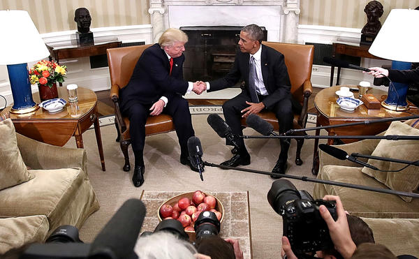 President Barack Obama and then-President-elect Donald Trump shake hands following a meeting in the Oval Office on Nov. 10. A former Obama official says Obama warned Trump about Michael Flynn, whom Trump later named as his national security adviser.