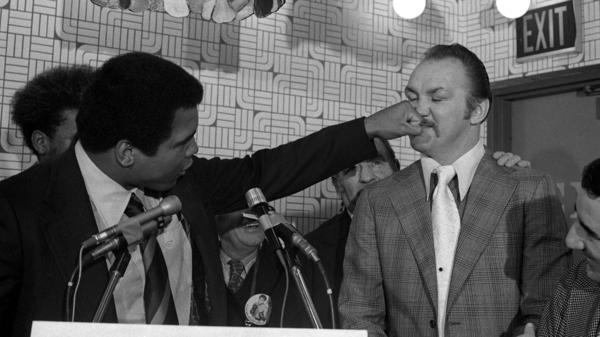 Muhammad Ali throws a playful punch at Chuck Wepner, ahead of their 1975 fight.