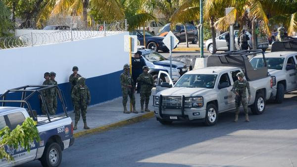 Mexican marines arrive after an attack against the building of the Quintana Roo State Prosecution in Cancun earlier this year. A new report on armed conflicts included Mexico's drug cartel violence in its rankings.