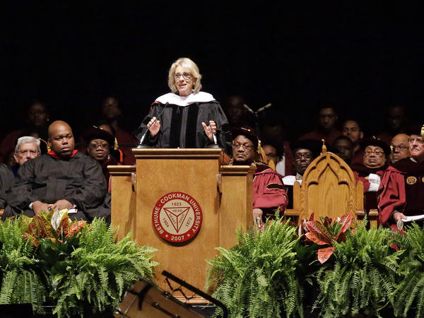 Education Secretary Betsy DeVos speaks to graduates at Bethune-Cookman University on Wednesday in Daytona Beach, Fla. For much of the address, she struggled to speak over boos and shouts from the crowd.