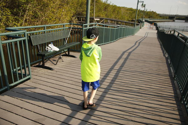 Ayden, 9, walks along a boardwalk at River Park Marina in Port St. Lucie, Fla. He has autism, ADHD and a seizure disorder, which many schools in the area are not equipped to help him with.