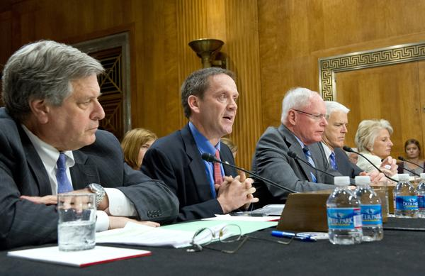 Mark Green, second from left, president of the International Republican Institute, testifies in 2014 before the U.S. Senate Foreign Relations Committee on Capitol Hill.